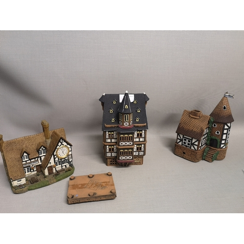 9 - A lot of three ceramic house ornaments, two by Kastel Keramik Haus...