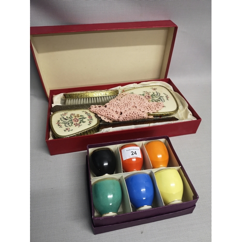 24 - A dressing table set (boxed), together with a lot of 6 egg cups (boxed...
