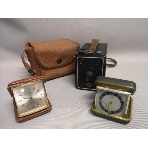 28 - Two travel clocks, makers Seiko & Junhans, together with an Agfa camera and case...