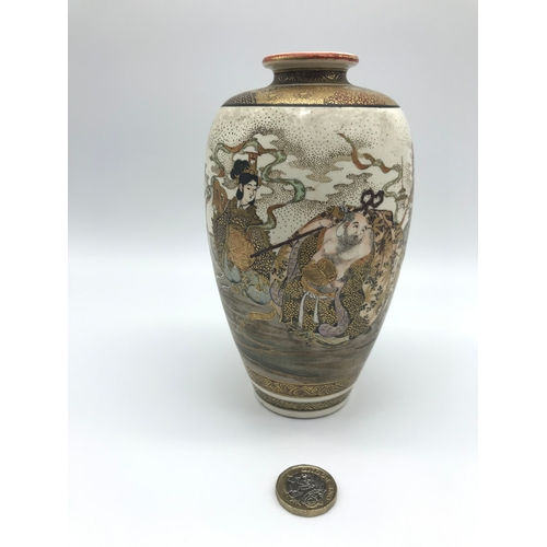 11 - A 19th century Japanese Satsuma highly decorated vase. Depicting The Seven Lucky gods of Japan, figu...