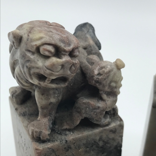 12 - A Lot of seven 19th century Soapstone Japanese/ Chinese seals, Two have carved foo dogs to the tops....