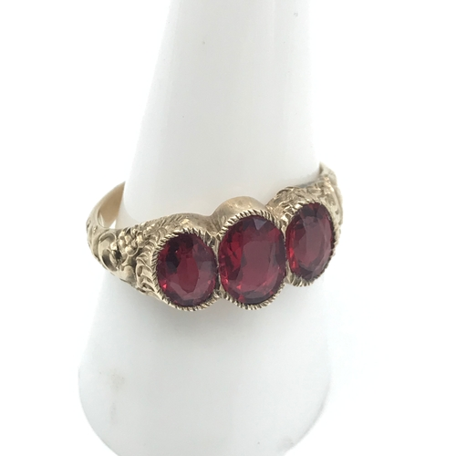 2 - A Victorian ornate ladies gold ring set with 3 large ruby stones, Ring size P, Largest measures 8x5....