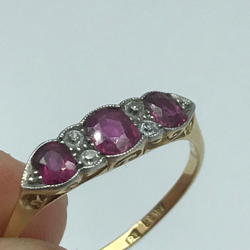 3 - An 18ct gold ladies ring set with 3 Ruby stones and four diamonds. Ring size T....