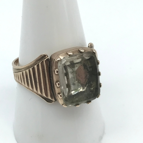 5 - A Victorian gents gold ring set with a large clear stone, Ring size S. Weighs 4.62grams...