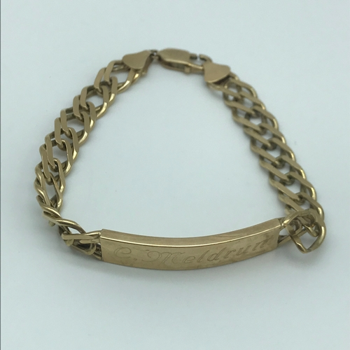 14 - A 9ct gold gents curb I.D Bracelet, Engraved (Could be buffered off) Measures 20.5cm in length and w...