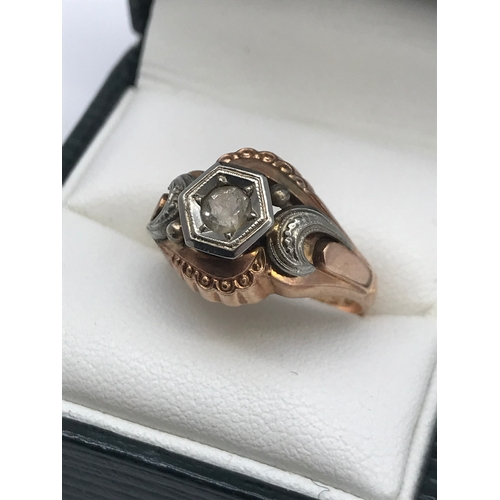 17 - An Antique gold and white metal gents ring, designed with a single clear stone, Ring size P, Stamped...