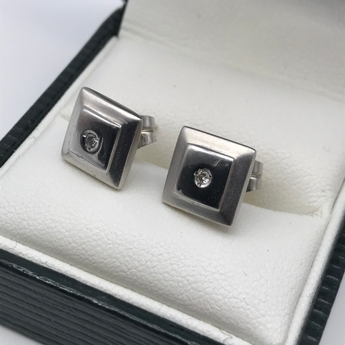 20 - A Pair of 18ct white gold square earrings set with single diamond stones to each, Weighs 2.23grams...
