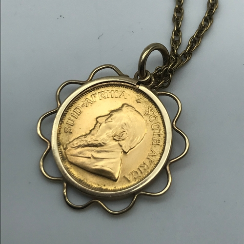 21 - A 1/10 Oz gold Krugerrand dated 1981, fitted in a gold pendant casing and a 9ct gold chain, Chain we...