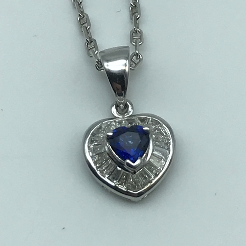 22 - An 18ct white gold necklace with a 18ct white gold diamond and sapphire heart shaped pendant, Weighs...