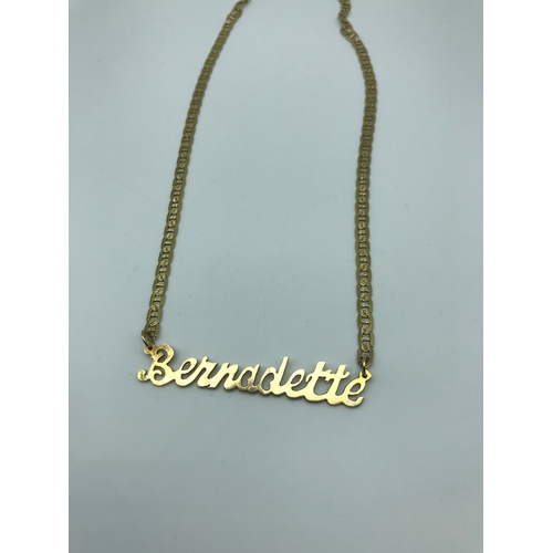 23 - A 14ct gold necklace and name pendant 'Bernadette' weighs 14.06 grams...