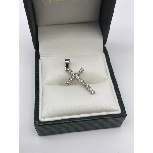 26 - An 18ct white gold and diamond cross pendant. Weighs 1.60grams...