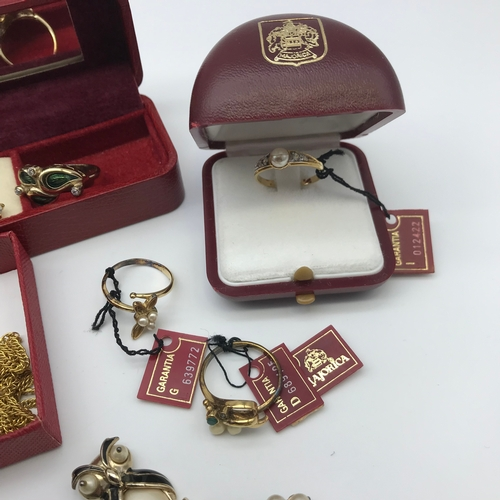 27 - A Collection of silver 925 gilt Majorica jewellery which includes brooches, rings and earrings...