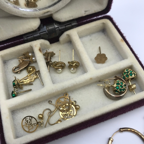 29 - A Box of gold and yellow metal earrings, Contains Approximately 5grams of gold...