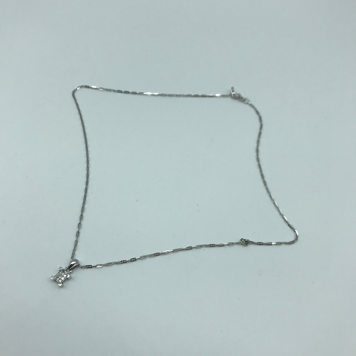 An 18ct white gold necklace together with 9ct white gold and