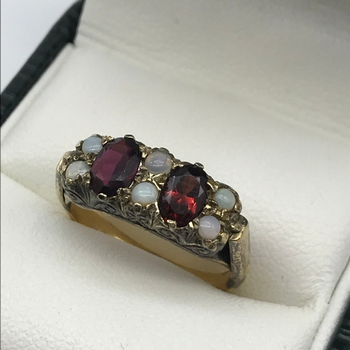 32 - A Birmingham gold and silver ladies opal and garnet ring, ring size M 1/2, Weighs 3.94 grams...