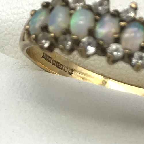 33 - A Ladies 9ct gold opal and cz stone ring, ring size Q 1/2, Weighs 2.06 grams...