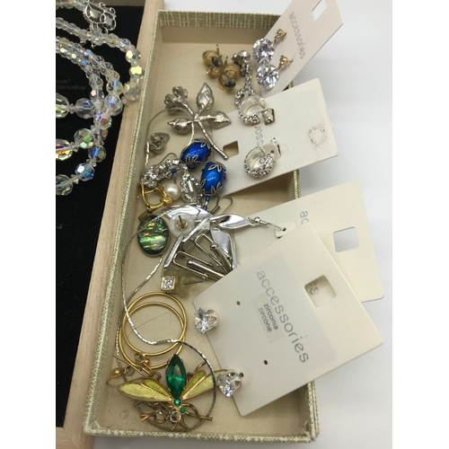37 - A Quantity of vintage costume jewellery, religious pendants and various modern carded earrings....