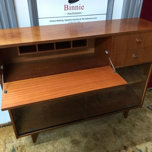 5a - A Mid century Avalon teak pedestal bookcase, set with 2 drawers, pull down front & two sliding glass...