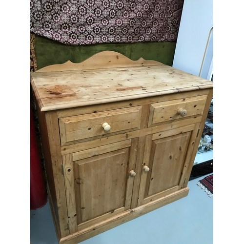 15a - Antique style pine two drawer, two door unit/ cabinet. Measures 110x107x55.5cm...