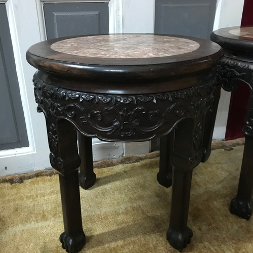 20a - A Pair of 18th/ 19th century oriental hand carved darkwood pedestal stand tables, designed with Gran...