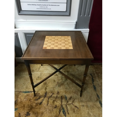 25a - A Regency style games table, Inlaid chess design to the top, removable top, supported on turned legs...