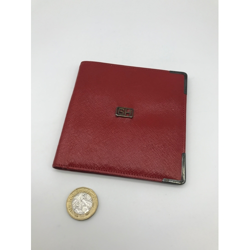 257 - Asprey of London red leather wallet with London silver corners and initials GH to the centre of the ...
