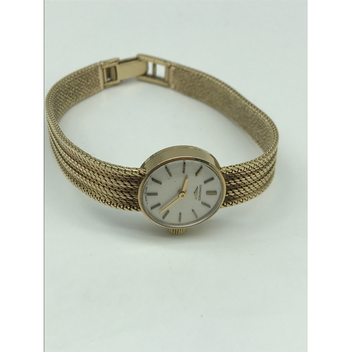 20B - A 9ct gold ladies Longines wrist watch. In a working condition....