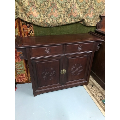 5A - A Solid hardwood oriental sideboard, Two drawer & two doors, Measures 89.5x120x38cm...