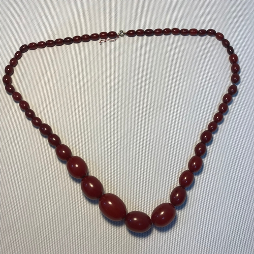 5 - A Early 1900's cherry amber graduating bead necklace,Measures 36.5cm drop. Weighs 73.10grams...