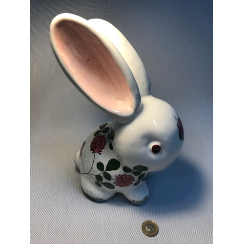 15 - A Large Plichta London porcelain rabbit, designed with hand painted flower design, Measures 26.5cm i...