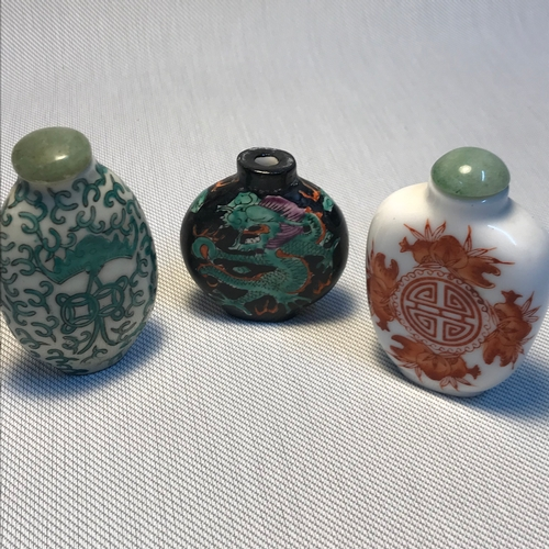 17 - A Lot of three early 20th century Chinese Snuff/ Perfume bottles. Tallest measures 7cm...