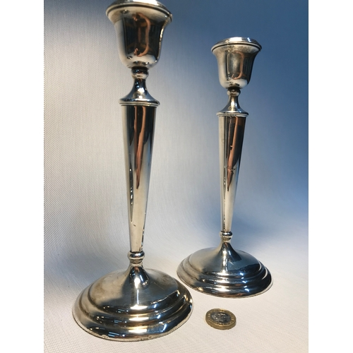 20 - A Pair of Birmingham silver candle sticks made by William Aitken. Measures 23cm in height...