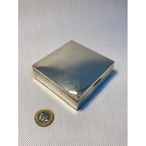 21 - A Chester silver cigarette box. Measures 3x8.5x8.5cm...