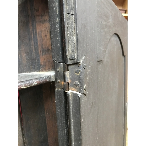 25A - A Late 17th Century wall hanging corner cupboard, showing signs of original hinges and condition. Me...