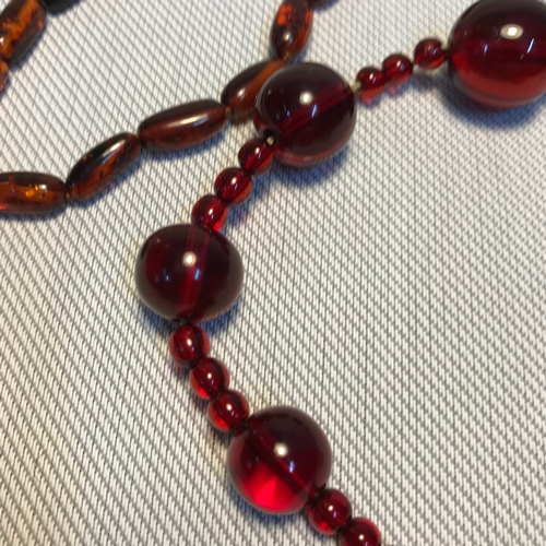 27 - A Lot of two early 1900's Cherry amber and amber bead necklaces, One needs restrung....
