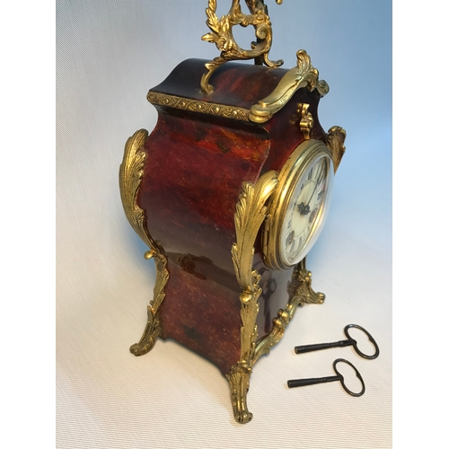 31 - A French 19th century Louis XIV Style tortoiseshell & Ormolu mounted mantle clock,.Ccomes with two k...