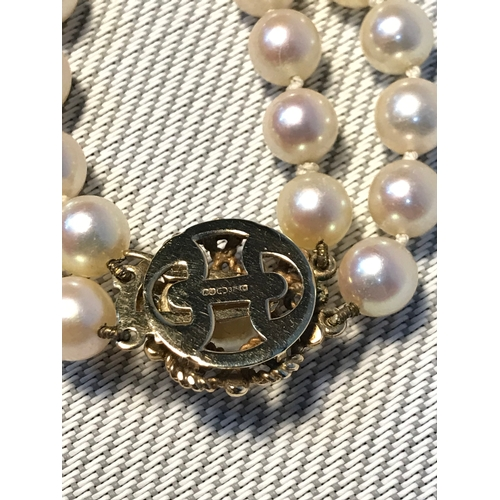 34 - A Vintage two strand pearl necklace fitted with a 9ct gold clasp....