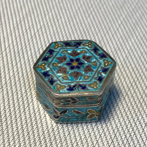 38 - A Small silver 925 and enamel Hexagonal shaped pill box. Designed in an Indian manner. Measures 2.5c...