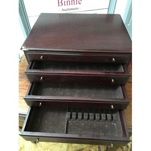 60A - A Vintage 4 drawer chest/ watch cabinet/ display chest. Fitted with small brass handles. Measures 28...