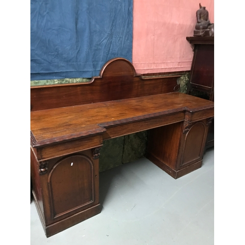 65A - A Victorian double pedestal sideboard, fitted with interior drawers, Measures 133x207x68cm...