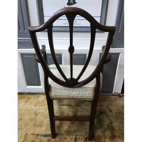 85A - A Georgian parlour arm chair, designed with a shield backing, Recently re- upholstered....
