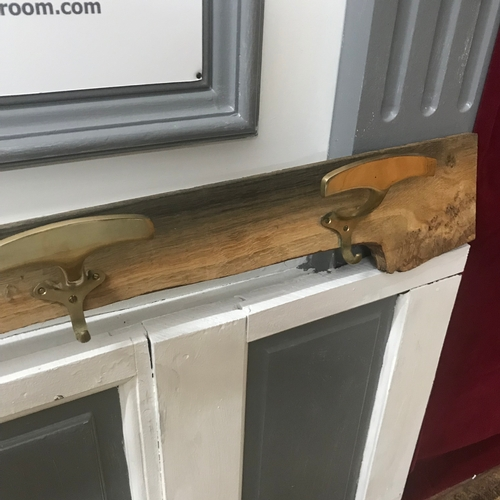 100A - A Large piece of drift wood designed with 4 Antique coat hangers. Measures 128.5cm in length...