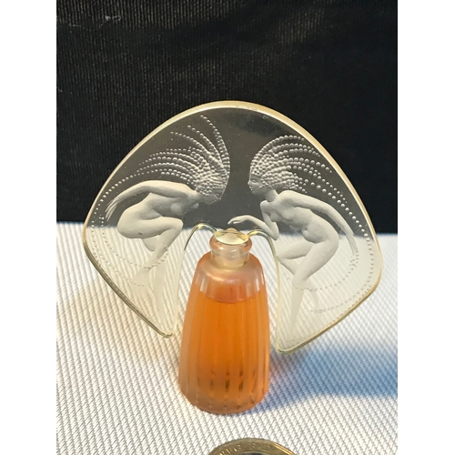 44 - A Lalique miniature perfume bottle 4.5ml France, Designed with two nude art nouveau lady figures to ...