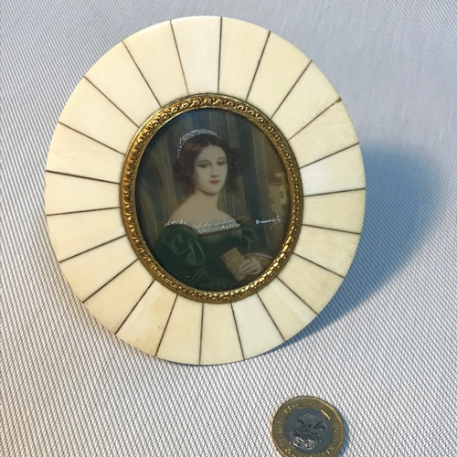 48 - A Victorian miniature portrait painting of a lady, signed by the artist. Fitted within a gilt brass ...