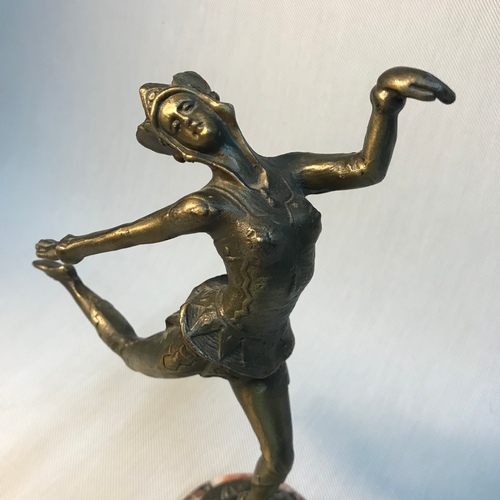 56 - A Bronze art nouveau dancing lady figure sat upon a marble base. Signed to the bronze base. Measures...