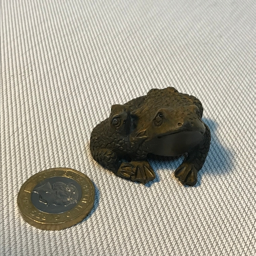 66 - A Japanese hand carved netsuke figure of two frogs. Signed to base by the artist. Measures 3.7cm in ...