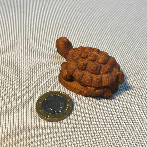 67 - A Small Japanese hand carved tortoise netsuke figure. Signed to the base, Measures 5.3cm in length....