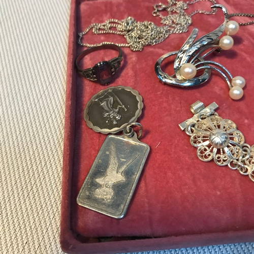 74 - A Selection of silver jewellery which includes Egyptian silver floral design bracelet, silver and pe...