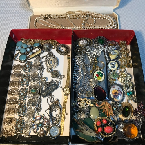 75 - A Collection of vintage costume jewellery which includes pearl necklaces, Scottish brooches, Stratto...