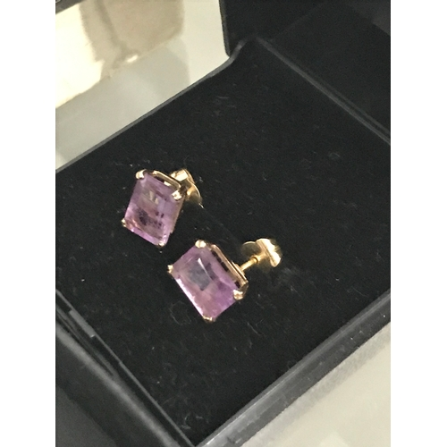 19 - A Pair of 18ct gold ladies earrings set with Baguette cut Amethyst stones. Stone measures 7.5x6mm,  ...
